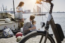 Portrait of family resting on pier of Elbe river — Stock Photo