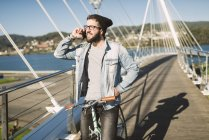 Casual young man talking by smartphone outdoors, Ferrol, Galicia, Spain — Stock Photo