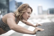 Close-up of Young woman exercising in city — Stock Photo