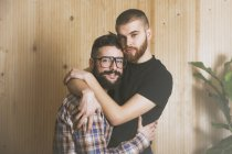 Portrait of embracing young gay couple — Stock Photo