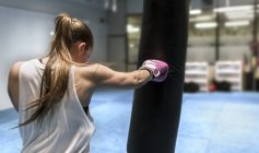 Young woman boxing in gym — Stock Photo