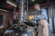 Man working at machine — Stock Photo