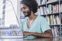 Man using futuristic computer — Stock Photo
