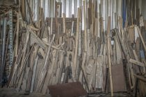 Pile of wood in workshop — Stock Photo