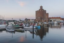 Fishing harbour and round silo — Stock Photo