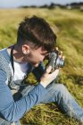 Man photographing with camera — Stock Photo