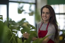 Young florist in her shop — Stock Photo