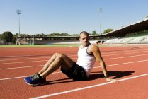 Young sportsman on running track — Stock Photo