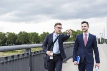 Businessmen walking together in city — Stock Photo