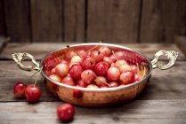 Organic cherries in sahan — Stock Photo