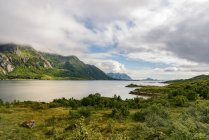 Norway, Lofoten, Austvagoya, view of river with hills on background — Stock Photo