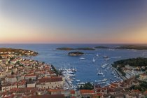 Hvar and harbour in the evening — Stock Photo