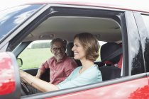 Happy mature couple driving  in car — Stock Photo