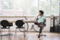 Designer sitting in modern office — Stock Photo