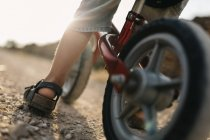 Boy with children's bike — Stock Photo