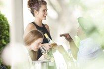 Attractive waitress in restaurant talking to man — Stock Photo