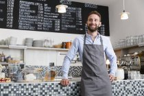 Smiling barista in a cafe — Stock Photo