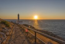 Sunrise and lighthouse at Italy — Stock Photo