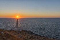Lever du soleil sur le phare — Photo de stock