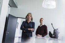 Senior woman and man in office — Stock Photo