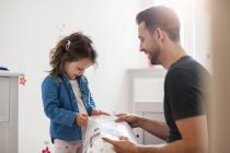 Father with daughter in children room — Stock Photo