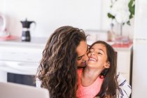 Playful teenage girl and her little sister at home — Stock Photo