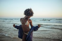 Woman dancing at the seafront — Stock Photo