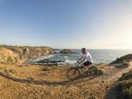 Senior man mountain biking — Stock Photo