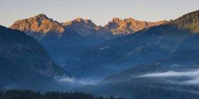 Germany, Bavaria, Stillach Valley near Oberstdorf, early morning fog, Schuesser, Hochgehrenspitze and Hammerspitze — Stock Photo