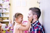 Father and daughter playing at home — Stock Photo
