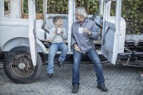 Man and boy having coffee break — Stock Photo