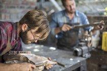 Bearded male sculptor working in studio — Stock Photo