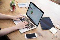 Woman using laptop — Stock Photo