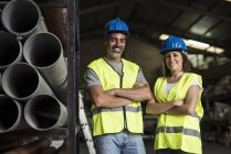 Construction workers standing in warehouse — Stock Photo