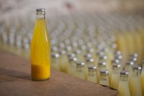 Bottle of juice in factory — Stock Photo