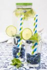 Glasses of infused water with lime — Stock Photo