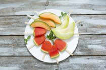 Plate of homemade watermelon ice lollies — Stock Photo