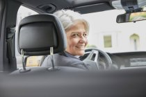 Businesswoman sitting in car — Stock Photo