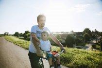 Little boy on bicycle — Stock Photo