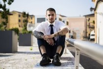 Young businessman with tatoos — Stock Photo