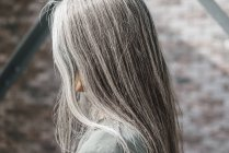 Close-up of female profile with long grey hair — Stock Photo