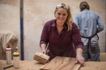 Man and woman working together in wood work workshop — Stock Photo