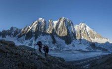 France, Chamonix, Argentiere Glacier, Les Droites, Les Courtes, Aiguille Verte, group of mountaineers trekking in alps — Stock Photo
