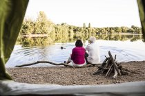 Senior couple camping at a lake — Stock Photo