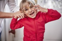 Portrait of playful girl wearing oversized glasses — Stock Photo