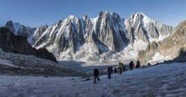 France, Chamonix, Argentiere Glacier, Les Droites, Les Courtes, Aiguille Verte, group of hikers walking in mountains — Stock Photo