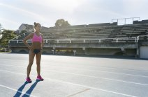 Portrait of latin sportwoman in an athletics stadium — Stock Photo