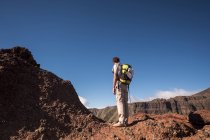 Spain, Tenerife, Teno Mountains, Masca, barefoot trekker standing and looking at view — Stock Photo
