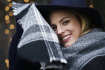 Portrait of smiling young woman with scarf — Stock Photo