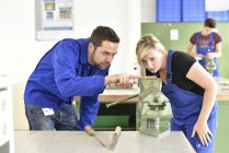 Instructor with trainee at workbench — Stock Photo